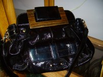 Zina Eva Leather Purse Black in color