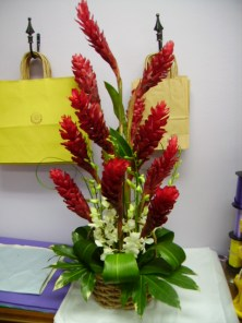 Red Ginger and white orchid tropical arrangement