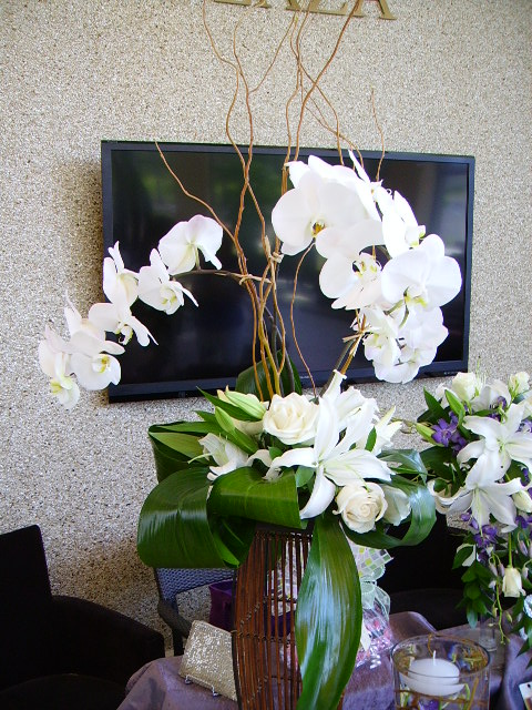 Orchid, lily and rose  tall centerpiece